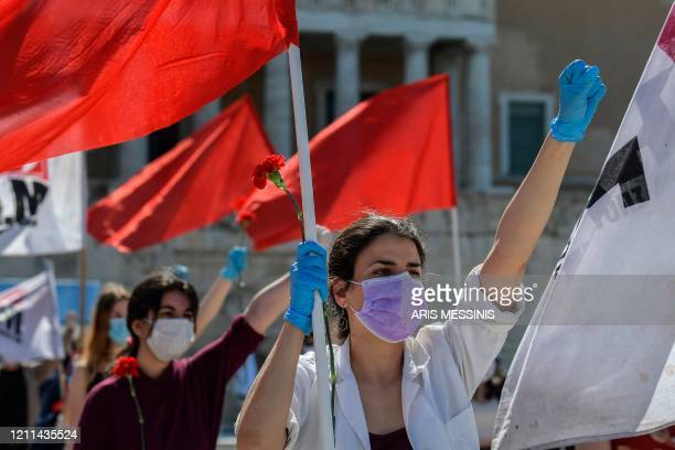 Members of the Greek Labour Union , wearing protective masks and respecting the social distances against the spread of the novel coronavirus,...