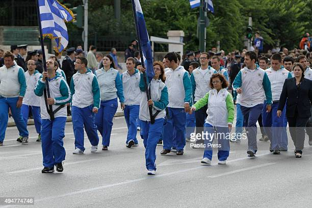 SQUARE ATHENS ATTICA GREECE Members of the Greek Special Olympics team march past the Greek Parliament and the review stands in the 'Oxi Day' parade...
