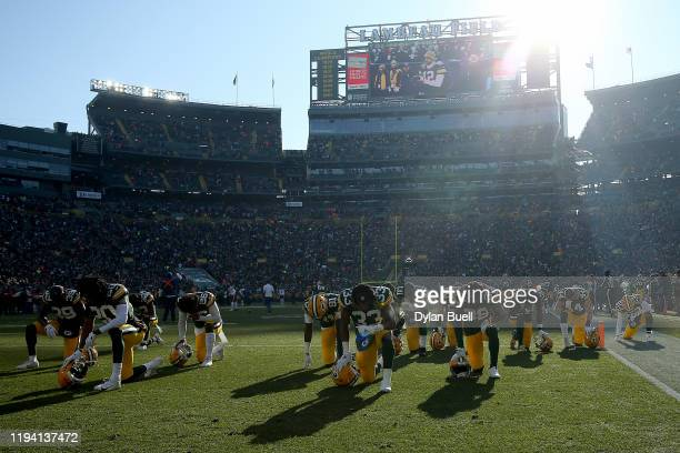 Members of the Green Bay Packers kneel before the game against the Chicago Bears at Lambeau Field on December 15 2019 in Green Bay Wisconsin