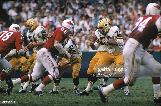 Members of the Green Bay Packers' offensive line meet the St Louis Cardinals defense at the line of scrimage during a game at Lambeau Field Green Bay...