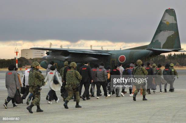 Members of the Ground SelfDefense Force and civilians take part in an emergency rescue drill at the Air SelfDefense Force's Iruma base in Sayama...
