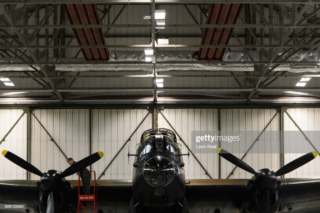 Members of the groundcrew work on one of two surviving airworthy Avro Lancaster bombers ahead of an event to mark the 75th anniversary of the 'Dambusters' raids, at RAF Coningsby on May 16, 2018 in Coningsby, England. The Royal Air Force Battle of Britain Memorial Flight was hoping to fly the Avro Lancaster bomber over the Derwent and Ladybower reservoirs, but high winds prevented the aircraft from taking off. 2018 marks the 100th anniversary of the formation of the RAF and the 75th anniversary of the 617 Squadron Dambusters operation. The Dambuster raids, or 'Operation Chastise' was an attack on German dams on 16-17 May 1943 by Royal Air Force No. 617 Squadron, using an innovative 'bouncing bomb', which skimmed on the surface of the reservoir before hitting the dam wall and exploding.
