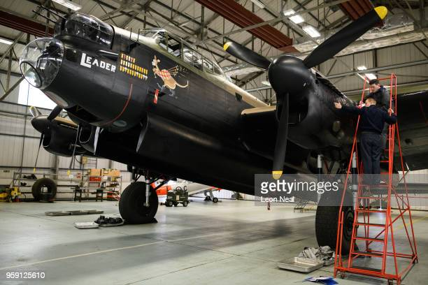 Members of the groundcrew work on one of two surviving airworthy Avro Lancaster bombers ahead of an event to mark the 75th anniversary of the...