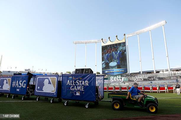 Members of the grounds crew drive a tractor off of the field during the 83rd MLB AllStar Game at Kauffman Stadium on July 10 2012 in Kansas City...