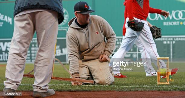 Members of the grounds crew drop a line in order to rechalk the right field foul line before the gameThe Boston Red Sox host the LA Dodgers in Game...