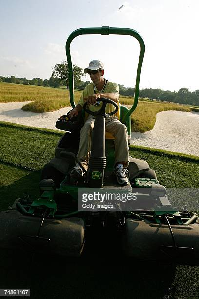 Members of the grounds crew operate mowers during the 107th U.S. Open Championship at Oakmont Country Club on June 13, 2007 in Oakmont, Pennsylvania.