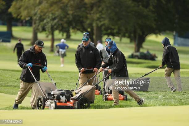 Members of the grounds crew tend to the course during a practice round prior to the 120th U.S. Open Championship on September 15, 2020 at Winged Foot...