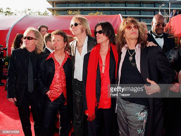 Members of the group Aerosmith arrive