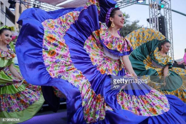 Members of the group Ballet Folklorico Orgullo de mi Tierra perform at the Mariachi Loco Music Festival May 06 2017 in El Paso Texas for the Cinco de...