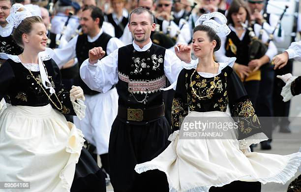 Members of the 'groupe celtique de Bannalec' perform gaellic dance on August 2 2009 in Lorient western France during the celtics nations Great Parade...