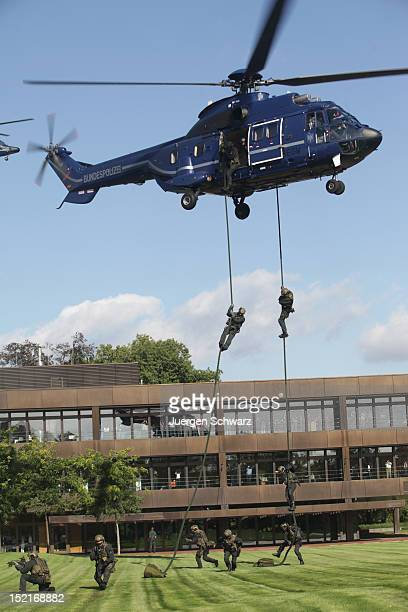 Members of the GSG 9 antiterrorism unit of the German Federal Police demonstrate their capabilities at a media event on September 14 2012 in Bonn...