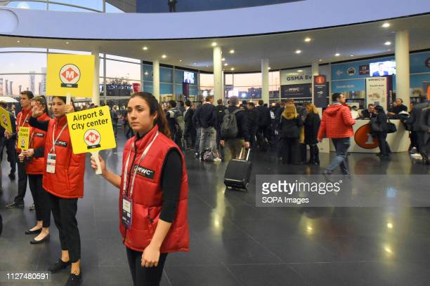 L´HOSPITALET CATALONIA SPAIN Members of the GSM Staff are seen helping visitors at the exit to access the means of transport of Barcelona at the...
