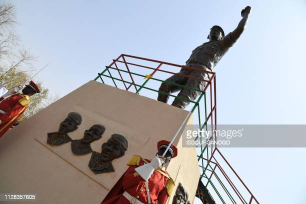Members of the guard of honor stand guard under the bronze statue of Burkina Faso's former President Thomas Sankara who was killed on October 15 on...
