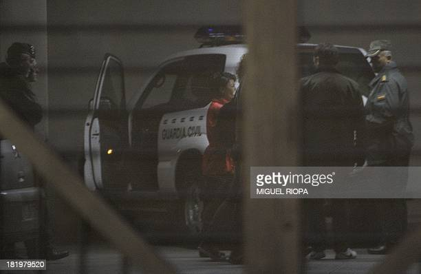 Members of the Guardia Civil escort Spanish lawyer Rosario Porto on arrival at the court in Santiago de Compostela on September 27 2013 Police said...