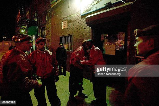 Members of the Guardian Angels, a volunteer community service organization, provide security at a social hall for a Mexican party in Corona November...
