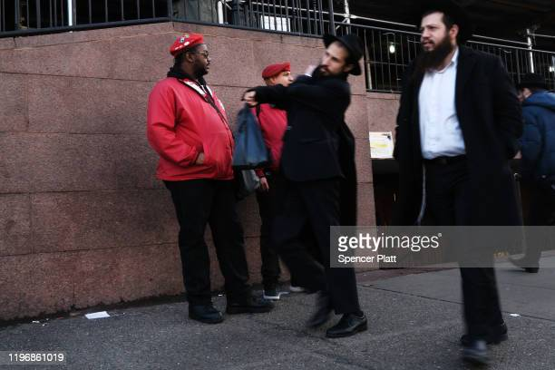 Members of the Guardian Angels patrol in Crown Heights Brooklyn on December 31 2019 in New York City Five Orthodox Jews were stabbed at a synagogue...