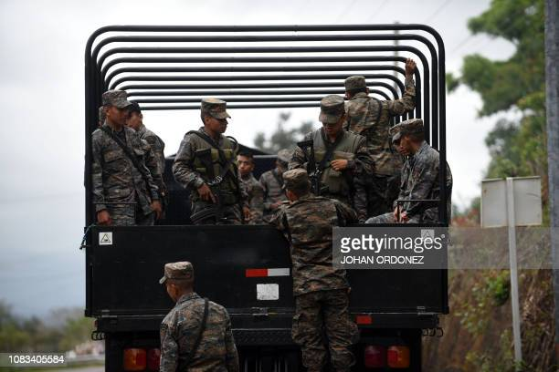 Members of the Guatemalan army stand by as Honduran migrants continue to head to the United States with a second caravan after reaching an agreement...
