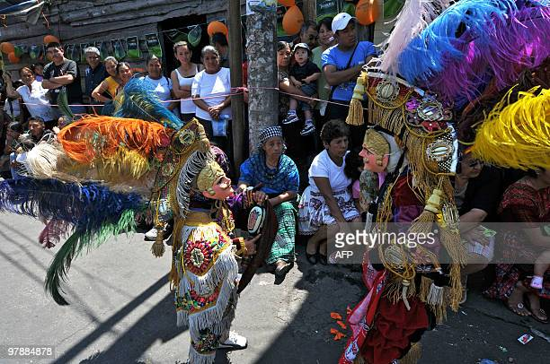 Members of the Guatemalan folk group 'Nure' perform the traditional 'El Torito' dance on March 19 2010 during the celebration of Saint Joseph's Day...