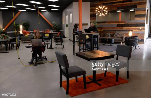 Members of The Guild Amy Sargent left and Heath Volmer make use of their new coworking space on March 1 2017 in Englewood Colorado According to staff...