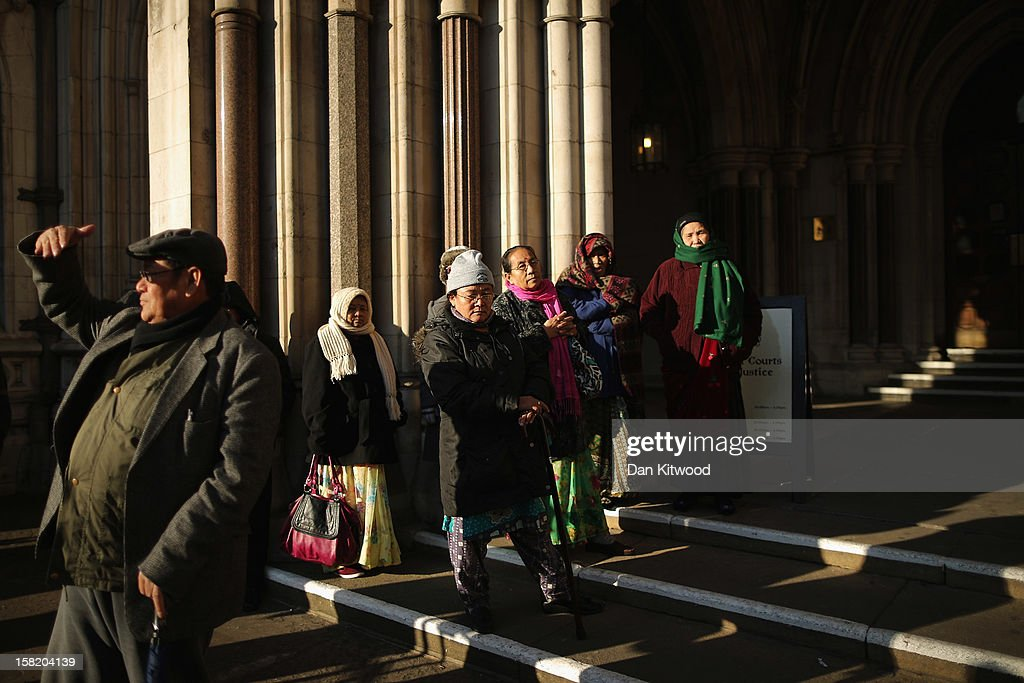 Members of the Gurkha community gather outside the High Court on December 11, 2012 in London, England. Members of the Gurkha community in the UK are continuing their fight for their children to settle in Britain despite losing a test-case at the high court in June 2012, when four adult children of Nepalese fighters were refused the right to settle in the UK.