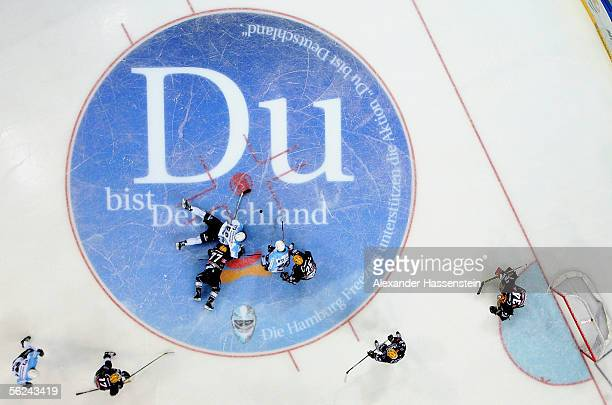 Members of the Hamburg Freezers and Frankfurt Lions are seen in this general view scating across a campaign logo which reads 'You are Germany' during...