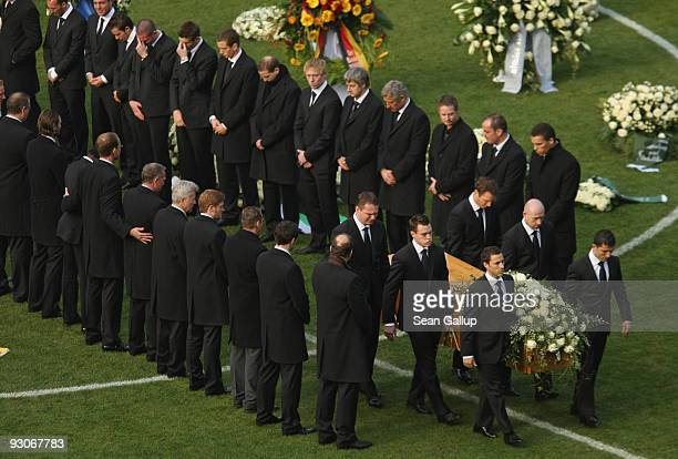 Members of the Hannover 96 football club carry the coffin of Hannover 96 goalkeeper Robert Enke at the conclusion of a memorial service prior to...