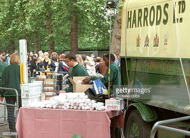 Members of the 'Harrods' staff04 September supply free refreshments to the crowds that have been forming outside Buckingham Palace ever since hearing...