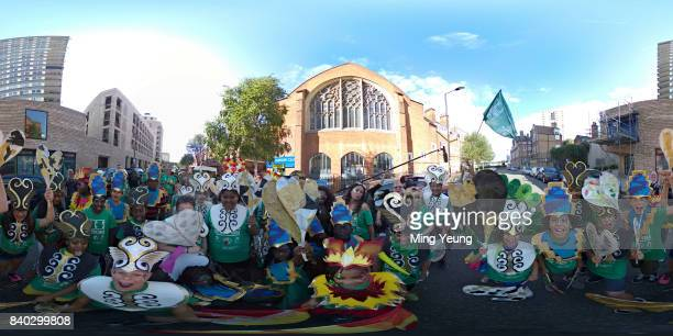 Members of The Harrow Club pose for a 360 portrait as they make their way to their float during the Notting Hill Carnival 2017 on August 27 2017 in...
