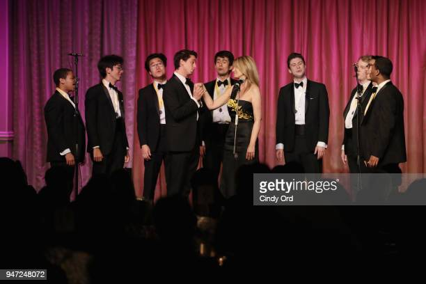 Members of The Harvard Krokodiloes and Lia Vollack perform onstage as the Hasty Pudding Institute awards Derek McLane with the Order of the Golden...