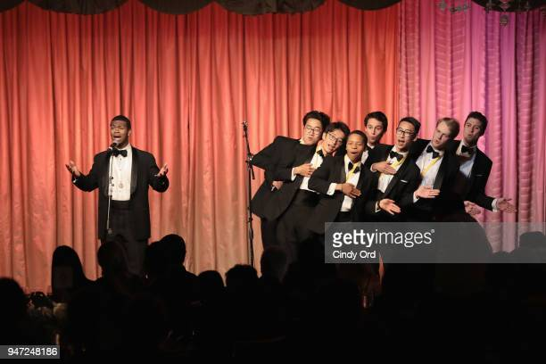 Members of The Harvard Krokodiloes perform onstage as the Hasty Pudding Institute awards Derek McLane with the Order of the Golden Sphinx at The...