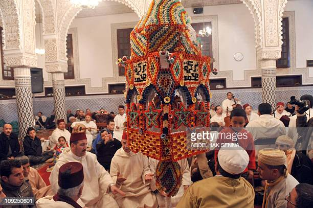 Members of the Hassounia brotherhood celebrate the birth of Prophet Mohammed known in Arabic as Mawlid alNabawi in Sale near Rabat early on February...