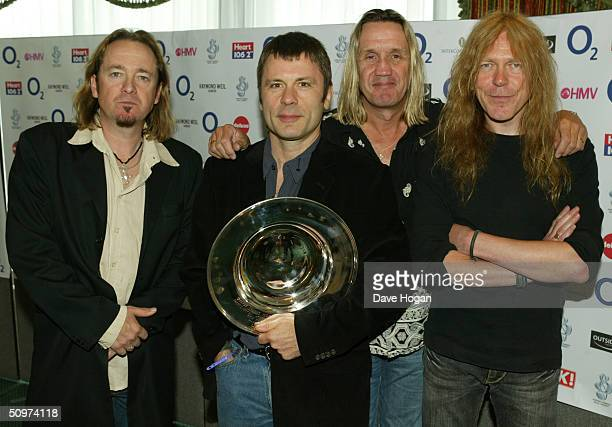Members of the heavy metal band Iron Maiden pose in the pressroom with the Deluxe Space Special Achievement Award at the NordoffRobbins O2 Silver...