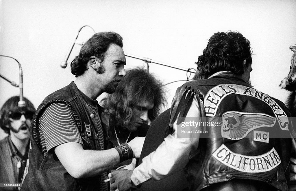 Members of the Hells Angels gang, acting as both security and hoodlums, jump the stage with Jorma Kaukonen of the Jefferson Airplane on December 6, 1969 at the Altamont Speedway outside of Livermore, California.