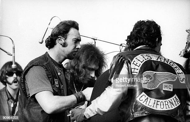 Members of the Hells Angels gang acting as both security and hoodlums jump the stage with Jorma Kaukonen of the Jefferson Airplane on December 6 1969...