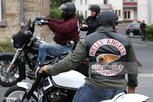 Members Of The Hells Angels Motorcycle Gang Wear Gear With