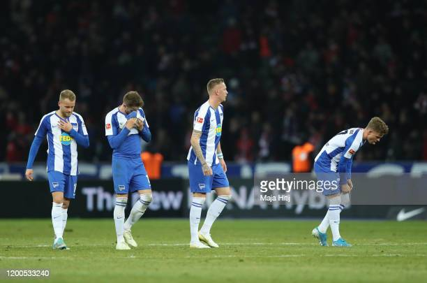 Members of the Hertha BSC side cut dejected figures at the final whistle during the Bundesliga match between Hertha BSC and FC Bayern Muenchen at...