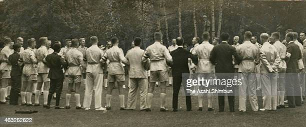 Members of the Hitler Youth form a huddle to sing a song on August 27 1938 in Karuizawa Nagano Japan