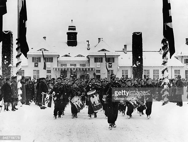 Members of the Hitler Youth marching into GarmischPartenkirchen on the opening of the Winter Games