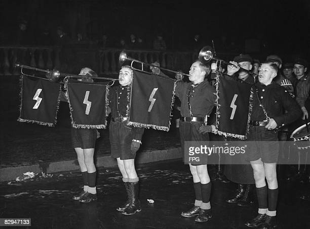 Members of the Hitler Youth play a fanfare in the Lustgarten, Berlin, at a youth rally to mark the integration of the Evangelische Jugend...