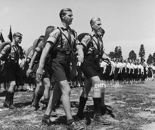 Members of the Hitler Youth set off on a route march, circa 1935.