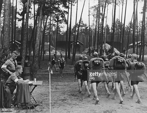Members of the Hitler Youth set off on a route march near Nuremberg, 9th September 1937.