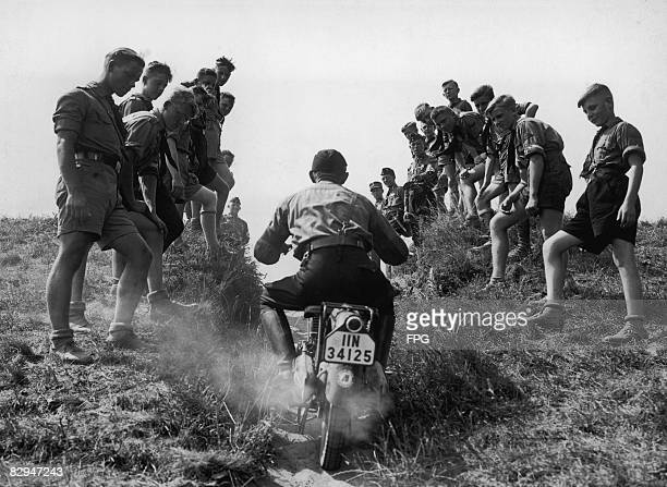 Members of the Hitler Youth watch a motorcycling event Germany circa 1936