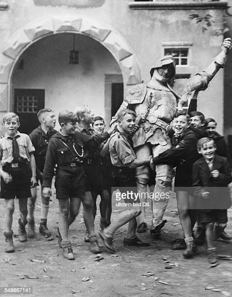 Members of the Hitler Youth with the statue of a knight which they have found near Storkow castle 1936 Published by 'Berliner Montagspost' Vintage...