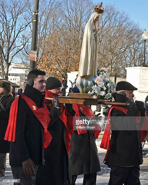 Members of the Holy Choir of Angels Corps carry a statue of the Blessed Virgin Mary at the conclusion of the annual March for Life, Jan. 22 in...