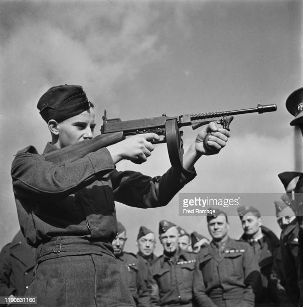Members of the Home Guard undergo weapons training with a 'Tommy gun' or Thompson submachine gun during World War II UK March 1941