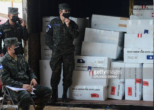 Members of the Honduran Army guard the electoral boxes of the primary elections in Tegucigalpa, on March 17, 2021. - The primary elections were held...