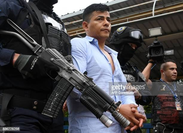 Members of the Honduran elite police unit Tigres escort Sergio Neptali Mejia Duarte wanted in the US for alleged drug trafficking before being...
