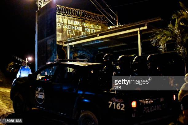 Members of the Honduras's Police Military arrive to the penitentiary of Tela Atlantida department Honduras on December 21 after a fight between rival...