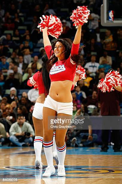Members of the Honeybees dance team perform during the game between the Charlotte Bobcats and the New Orleans Hornets on December 10 2008 at the New...
