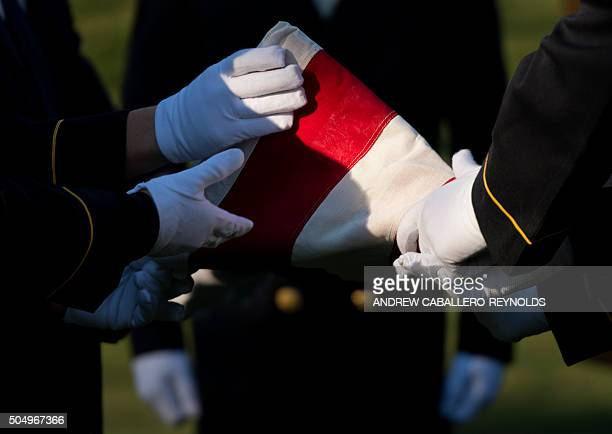 Members of the Honor Guard from the Army's 3rd US Infantry Regiment fold the US national flag during a memorial service for WWII Tuskegee Airman 2nd...